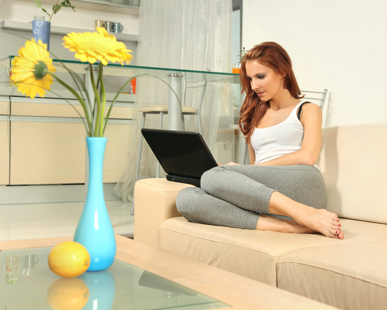 cute young woman with laptop